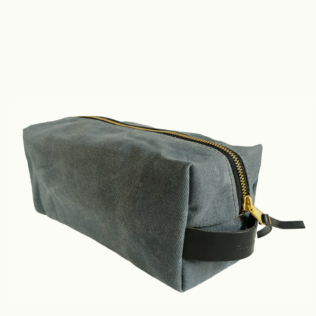 Hudson Made Slate Grey Dopp Kit with Embossed Hudson Made logo on the black saddle leather handle and a solid brass sturdy zipper.
