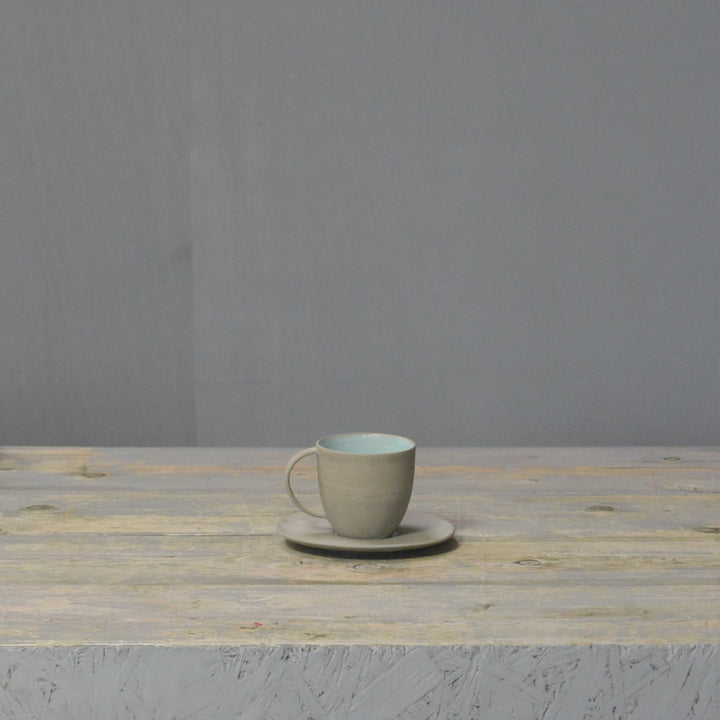 N&S Stone + Color - Coffee cup and saucer in grey and mint.