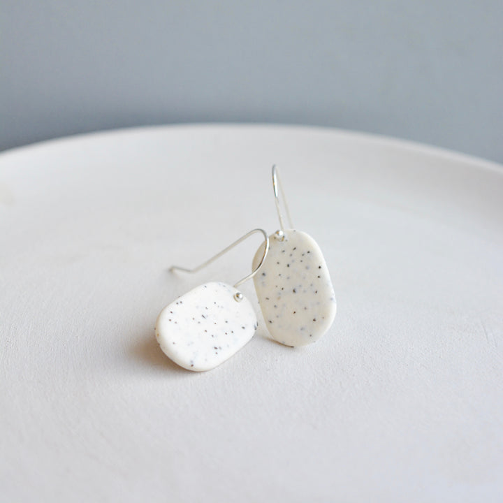 Porcelain earrings - Freckled pills - medium - white - small earwire