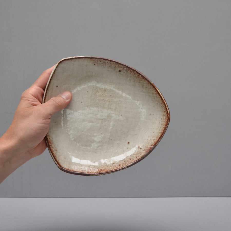 "Triangle low dish [medium 8""] - in Milky Canvas."