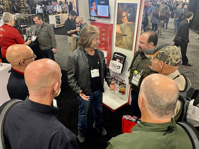 Retired company founder Howard Leight speaking with customers at SHOT show in Las Vegas