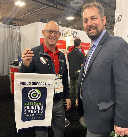 Chris Leight holding National Shooting Sports Banner at SHOT Show in Las Vegas