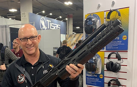 Chris Leight, son of Howard Leight, shown at the 2019 SHOT Show in Las Vegas holding Travis Gibson's 3-gun competition shotgun