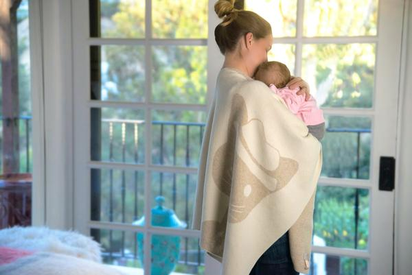 Image with baby blanket over mom and baby.