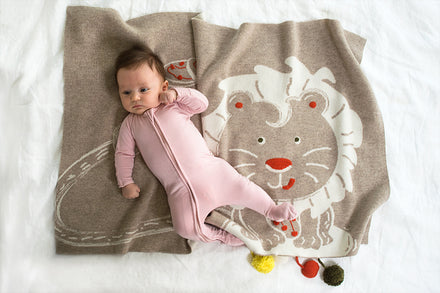 Image of baby and Liam the lion themed blanket