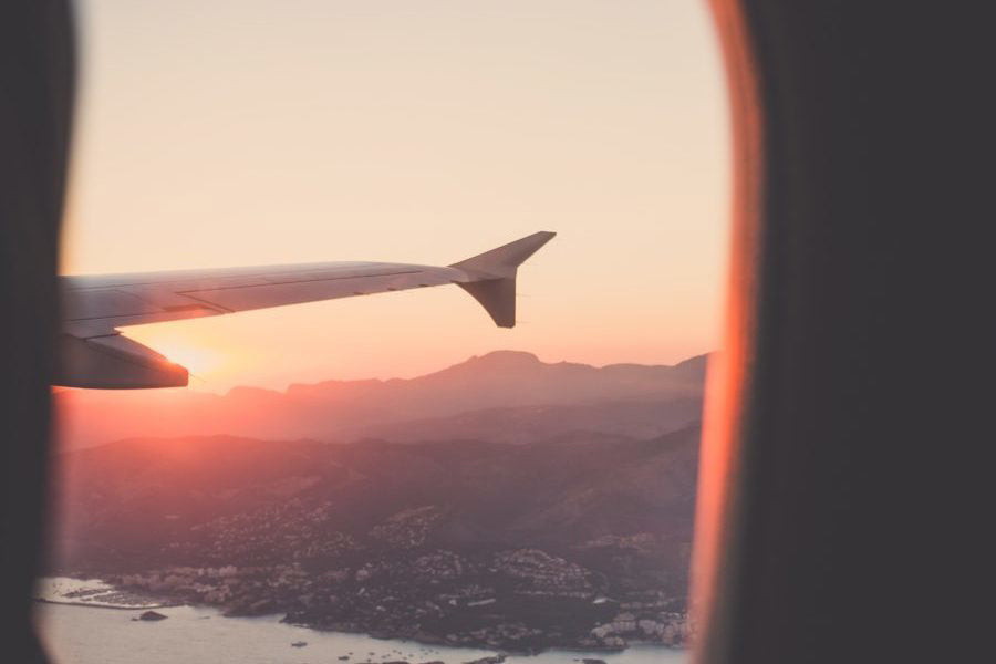 Image of a sunset from the window of a plane
