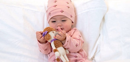 Image of baby with plush toy