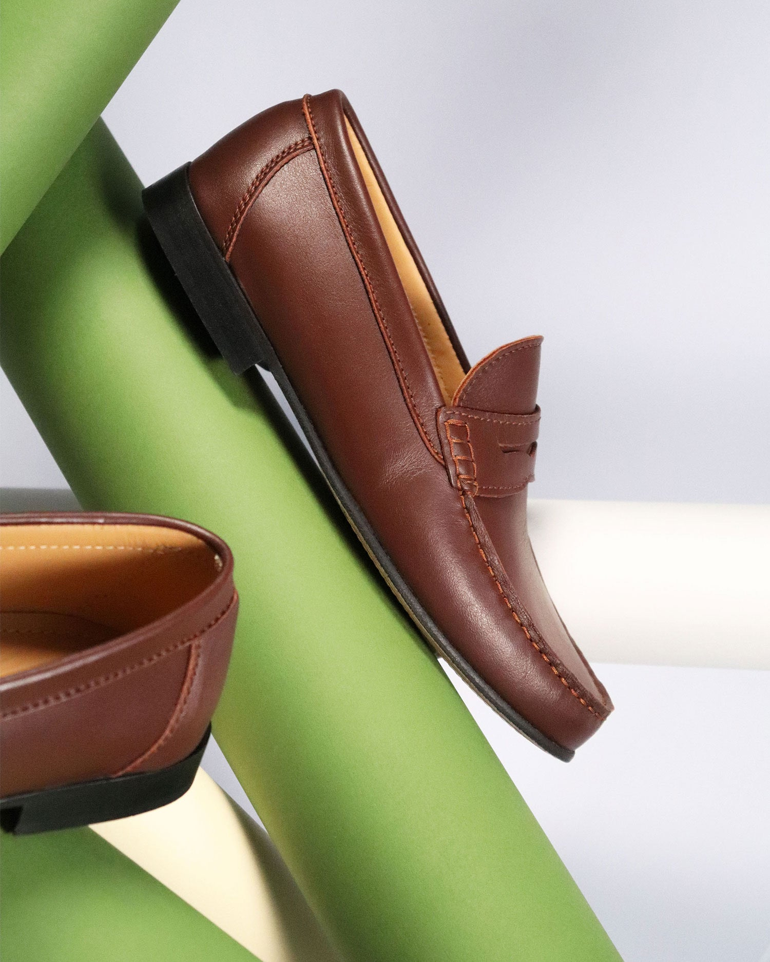 Brown penny loafers Hugs & Co.