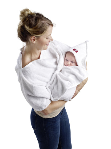 Baby in apron bath towel in mother's arms