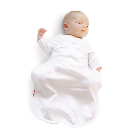 Baby asleep in Red Castle's swaddle blanket