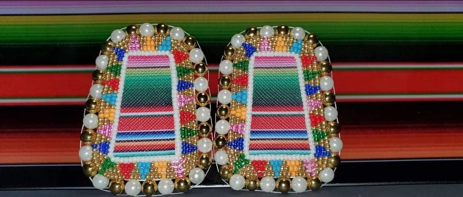 Oval-shaped-earrings-beaded-with-colorful-stripes-and-white-and-gold-beads