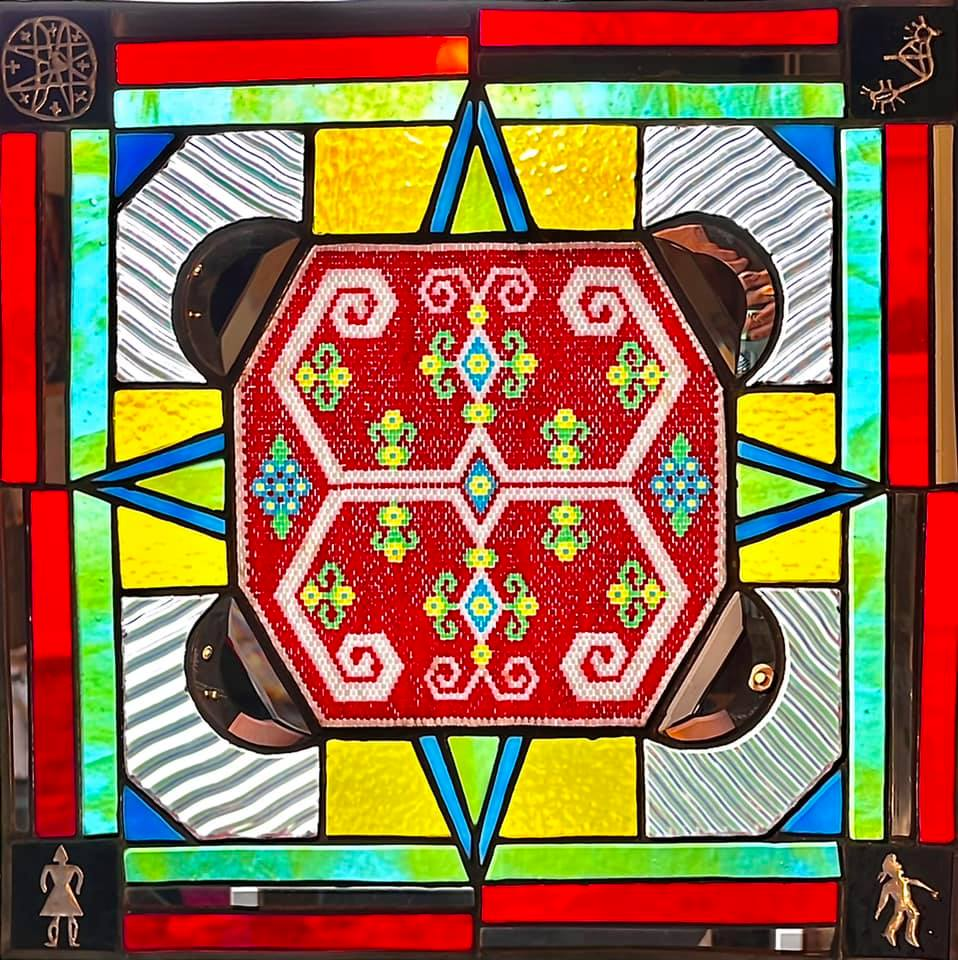 Stained-glass-and-beadword-composed-of-colorful-geometric-designs