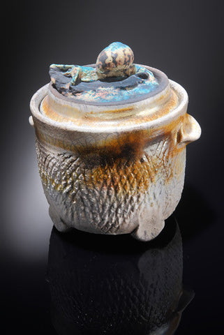 Picture of Zoomorphic Interloper Series: Raku fired pot with cast glass finial.