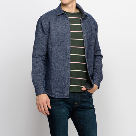 Porguguese flannel shirt layered over green APC shirt