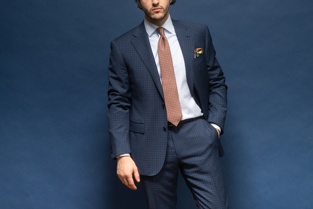 Business suit with tie - navy microcheck suit with solid shirt and rust coloured tie and pocket square