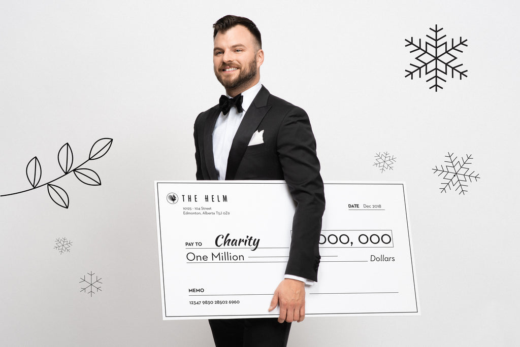 Formal gala outfit: Black tuxedo with a cheque for charity