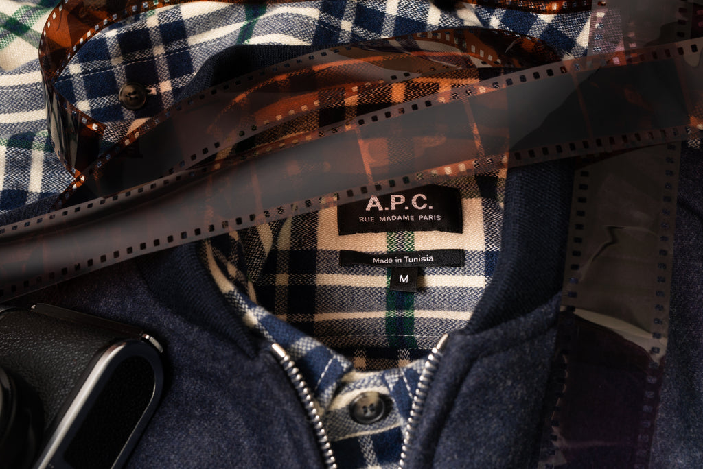 A.P.C. bomber and plaid sport shirt laid flat