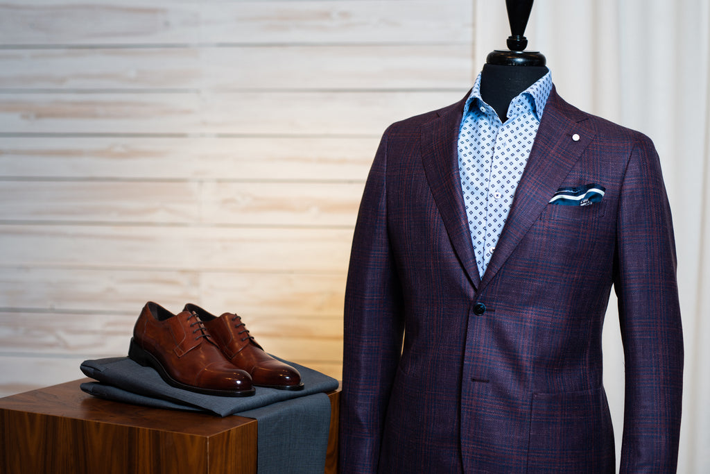Luigi Bianchi plum sport jacket worn with blue patterned dress shirt, grey trousers, and brown dress shoes