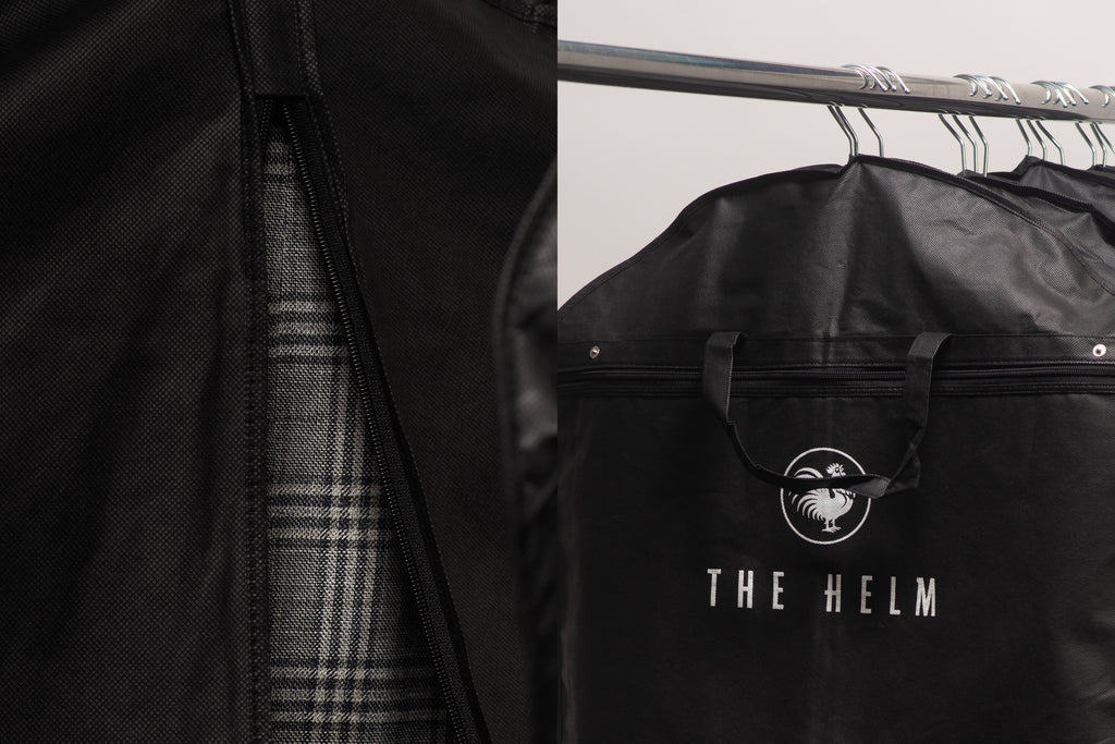 Black Helm garment bags hanging on a rack