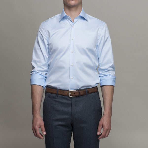 Dress shirt with rolled sleeves tucked in
