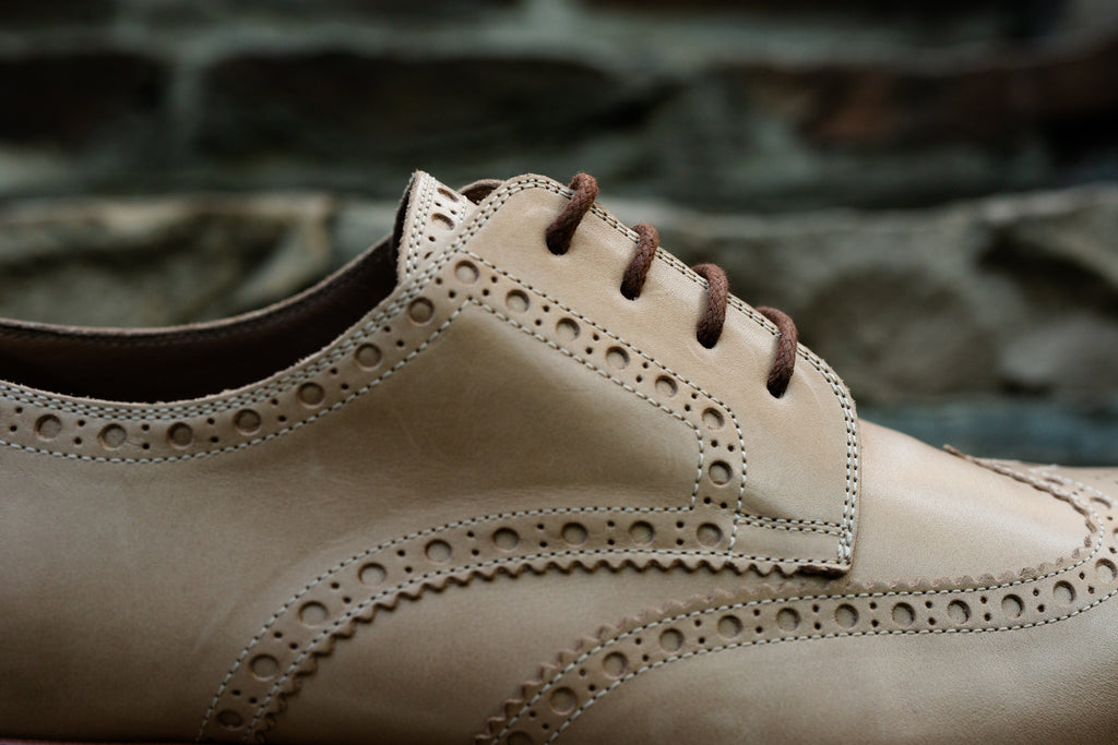 Light coloured brogue shoe