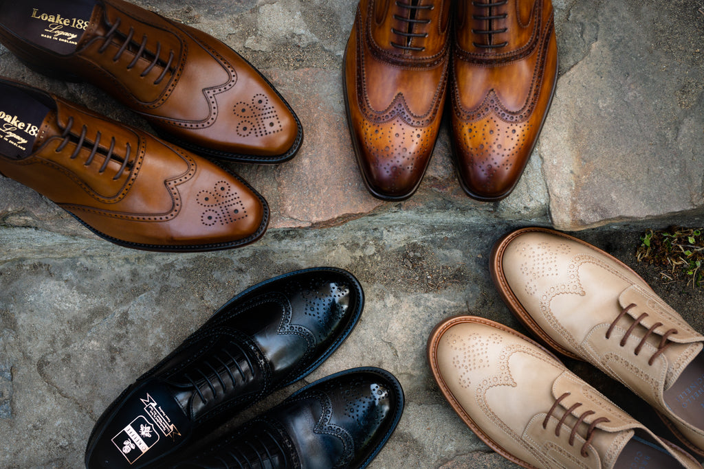 Four wingtip shoes in a circle