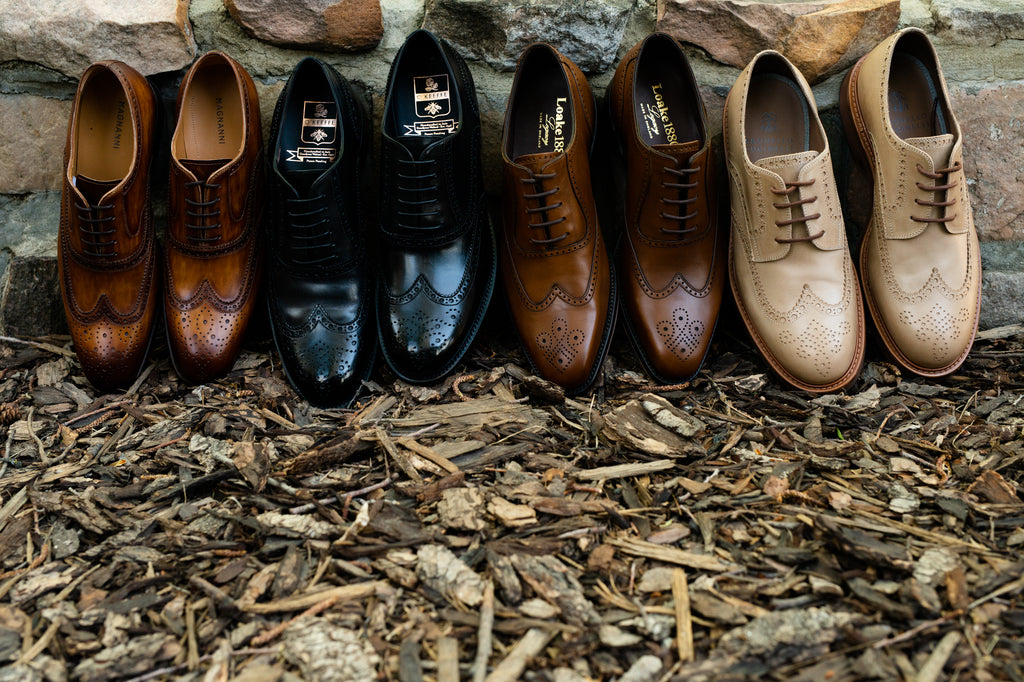 Four pairs of wingtip shoes