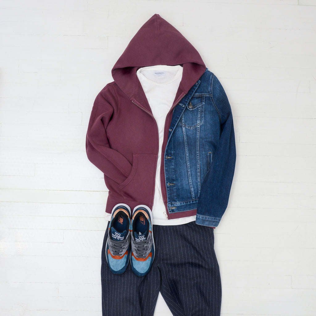 Bold shoes: Blue, rust, and grey new balance 999 shoes, pinstripe joggers, Alex Mill burgundy hoodie, President's white graphic t-shirt, FRAME denim jacket