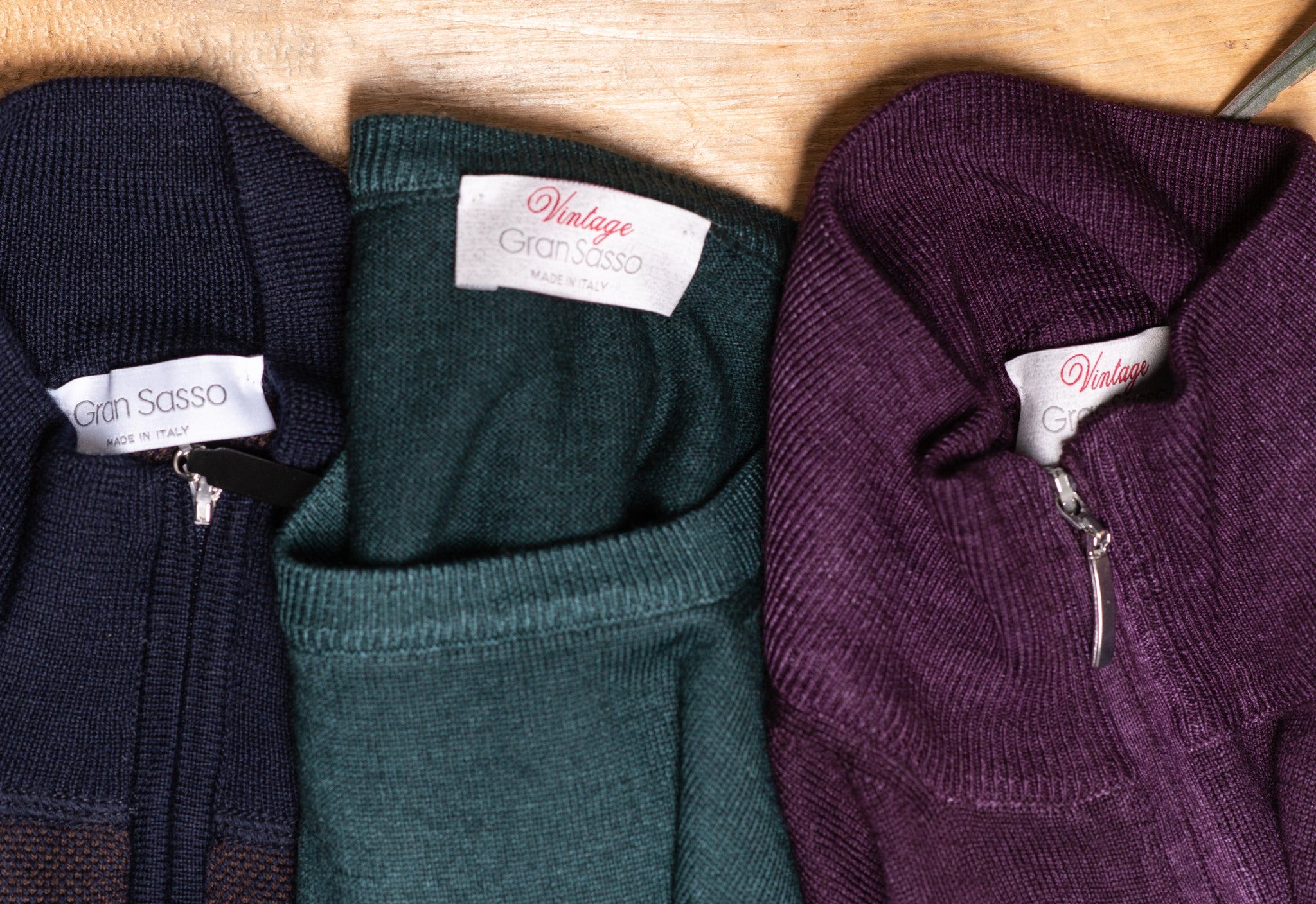 Navy, teal, and burgundy gran sasso sweaters