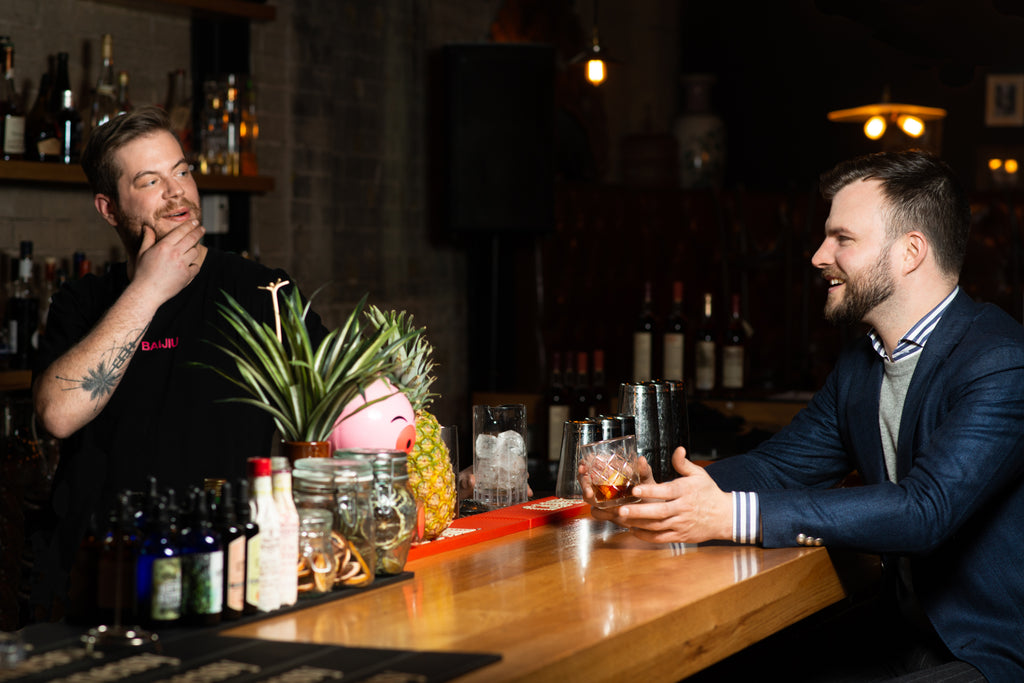 Andre Bober at Baijiu speaking to Chad Helm
