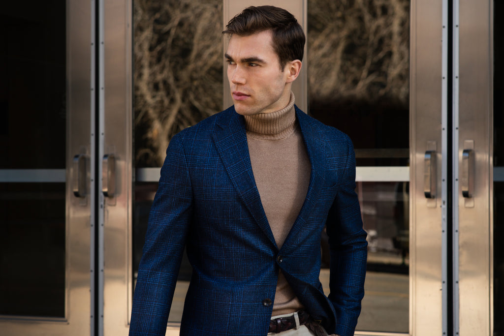 Steven wearing Helm Collection blue check sport jacket over roll neck sweater