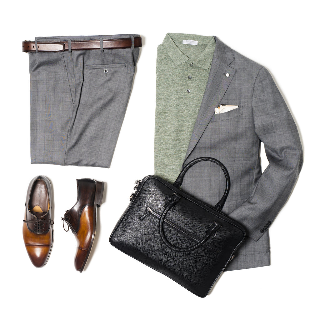 Knit polo with grey check suit and black briefcase