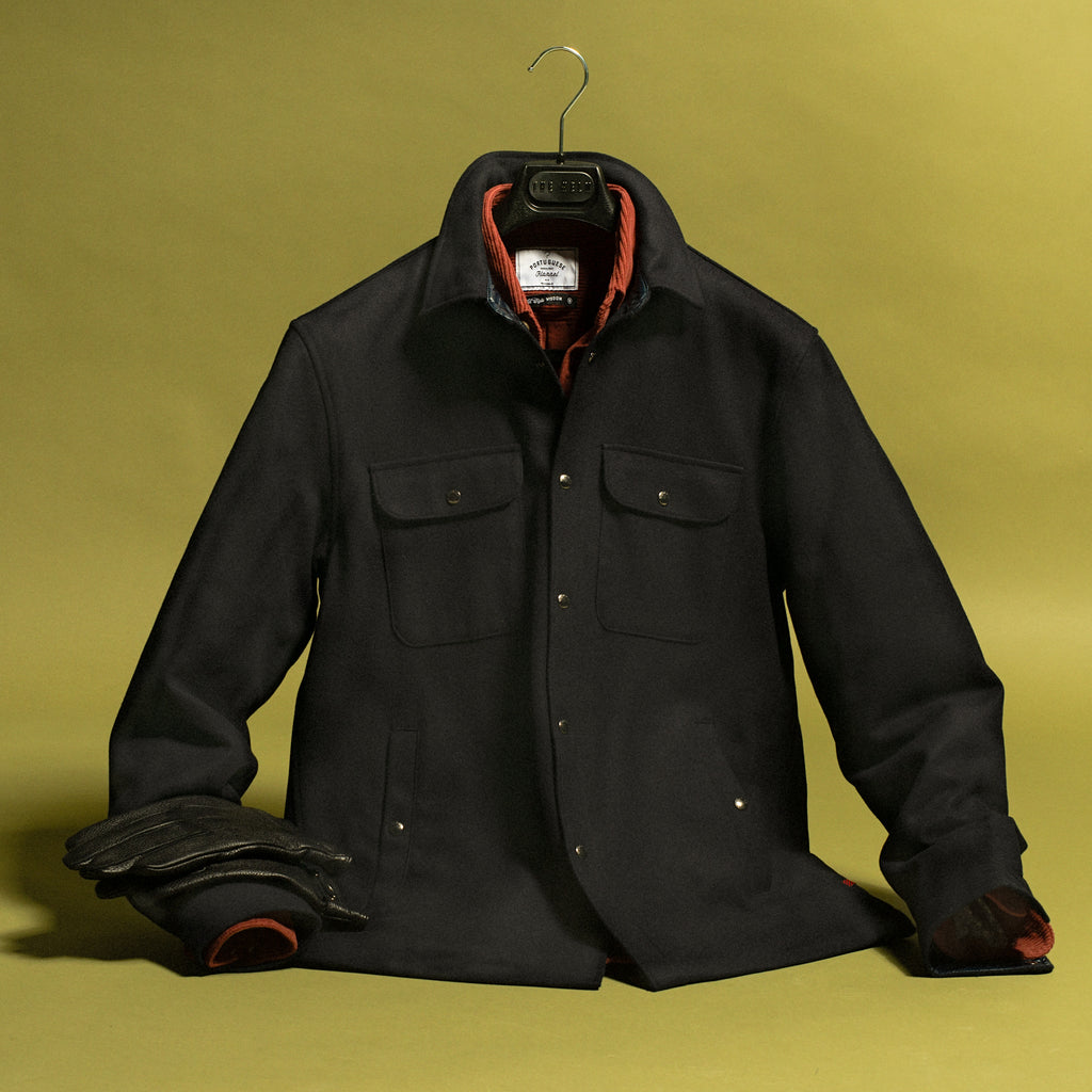 Navy alaskan overshirt with flannel shirt and dress gloves