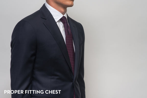 The chest of a suit that fits properly, showing no gape or break