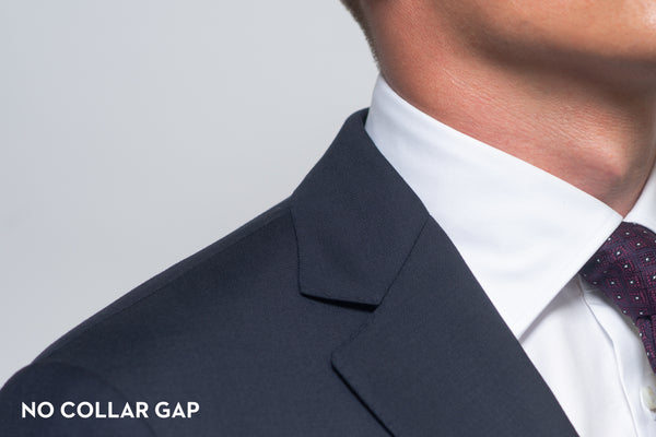 A suit that fits properly and shows no collar gap