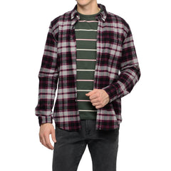Plad Portuguese flannel shirt layered over green APC shirt