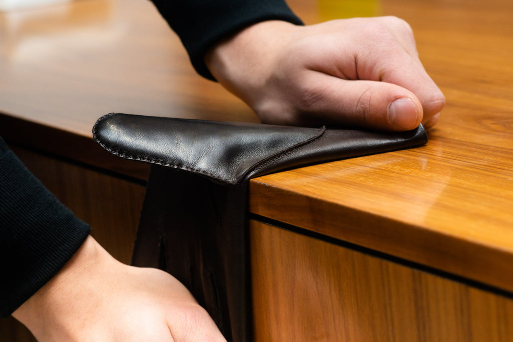Stretching a leather glove over a counter