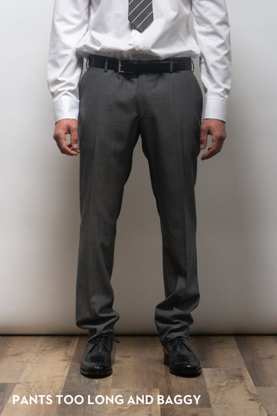Dress pants on a suit that is too long and too baggy