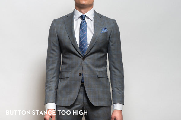 Button stance too high and popping on an ill-fitting suit that is too small