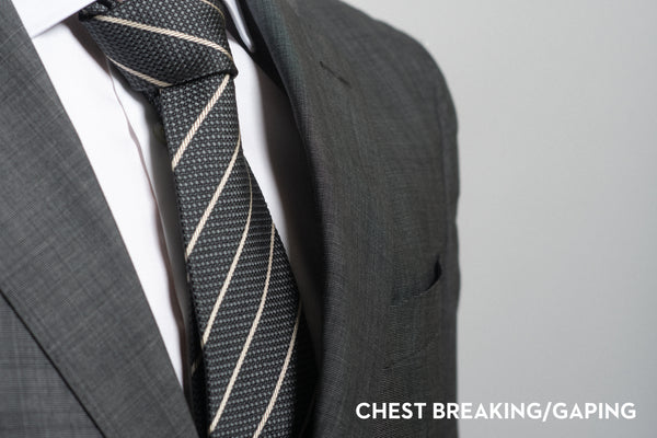 Chest gape on a suit that is too large or too small