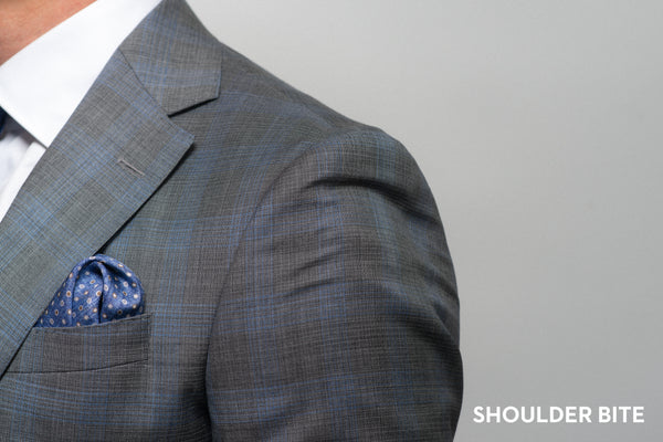 Shoulder bite on a suit that is too small