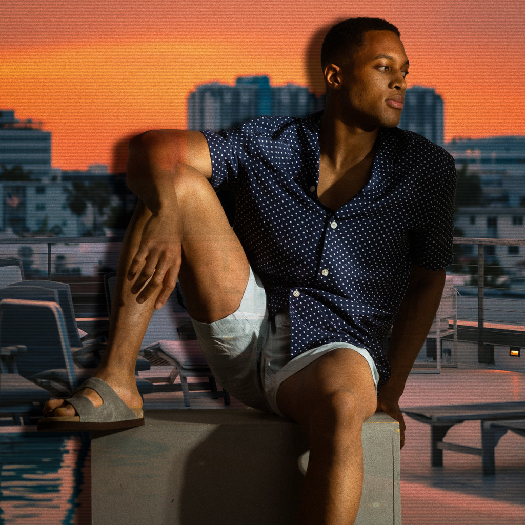 The south point pier look - navy dotted camp collar shirt worn with shorts and suede slides