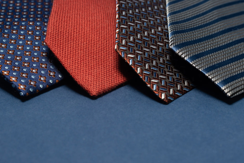 Variety of tie fabrics - silk and wool, patterned, solid, and striped