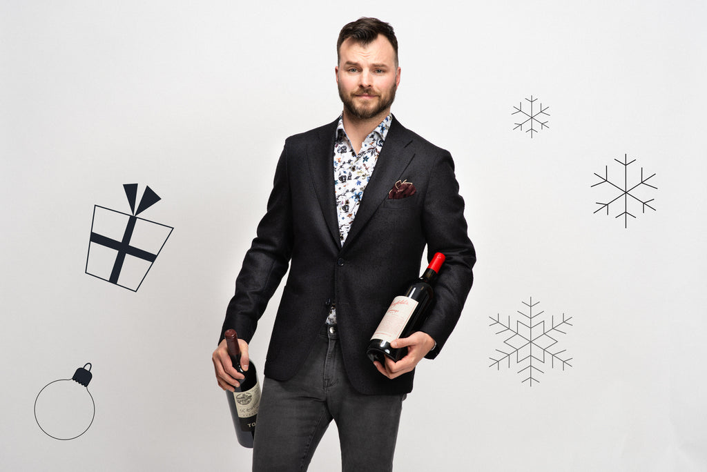 Dinner party outfit: Navy sport jacket, open collar floral shirt, grey jeans and two bottles of nice wine