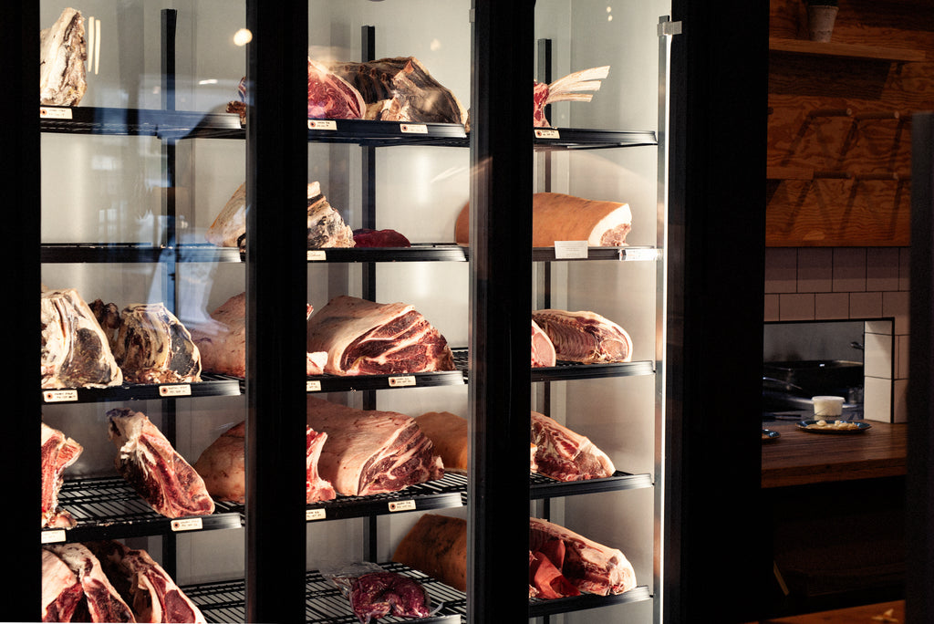 Dry aged meat cooler at Rge Rd with a selection of meats inside