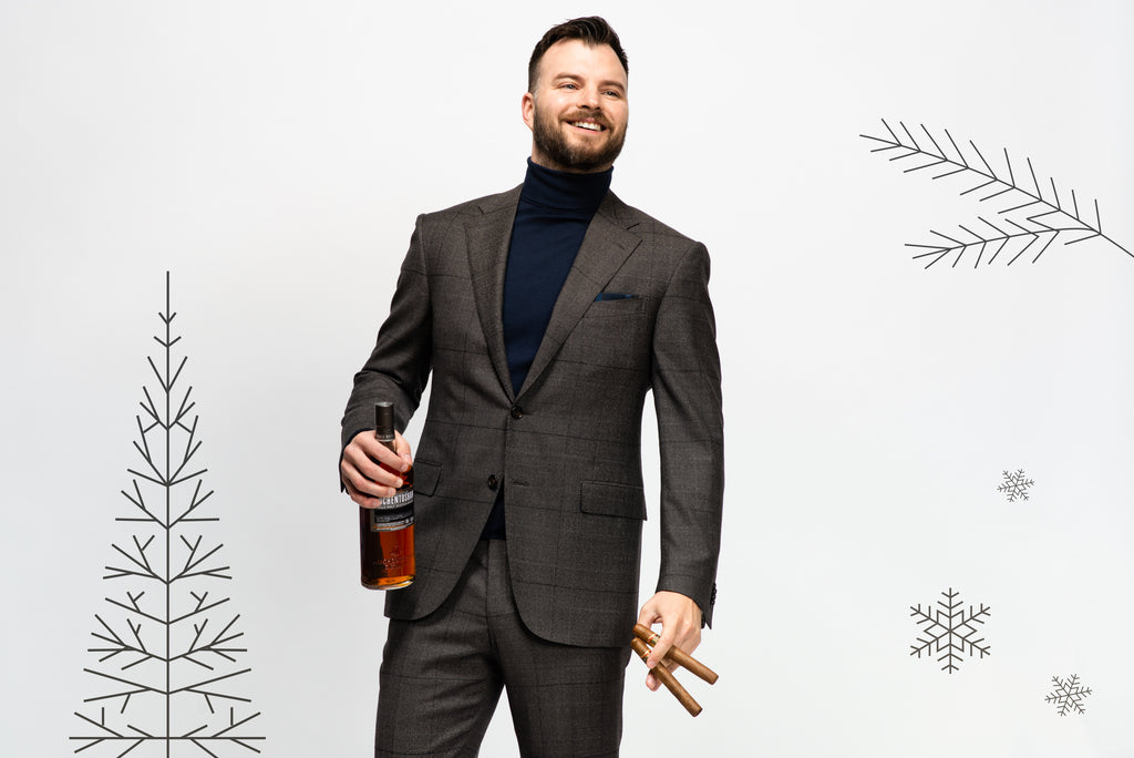 Office party outfit: Grey suit with navy roll neck sweater, two cigars and a bottle of scotch