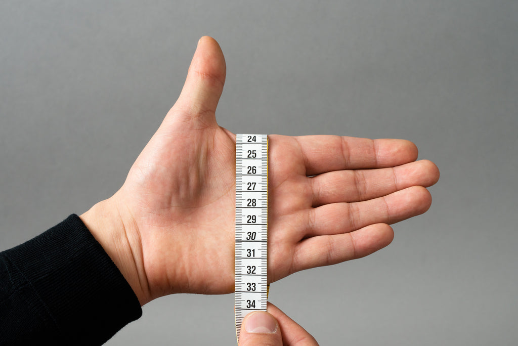 Measuring a hand for glove sizing