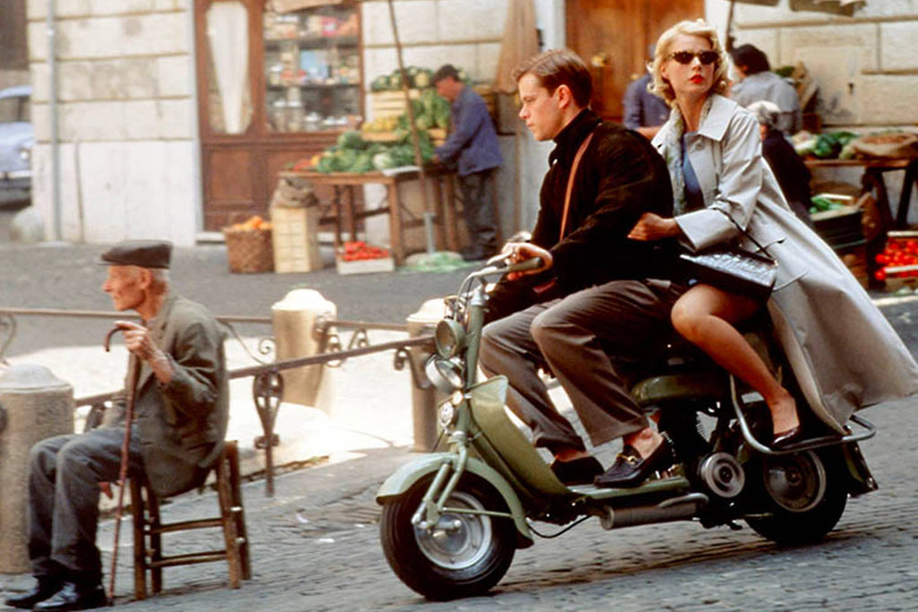 Matt Damon in talented mr ripley on scooter wearing loafers