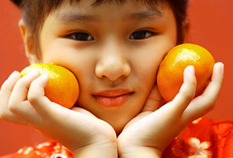 asian girl with orange