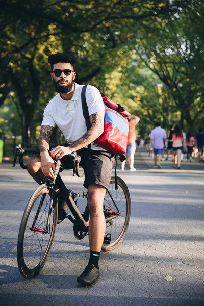 M24 lorry tarpaulin backpack being worn by a cyclist in central park